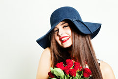 Beautiful Woman with Red Roses Stock Images
