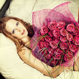 Beautiful woman with red roses Stock Photo