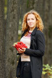 Beautiful woman with red rowanberry Royalty Free Stock Images