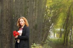 Beautiful woman with red rowanberry Royalty Free Stock Photography
