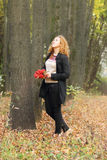 Beautiful woman with red rowanberry walks Royalty Free Stock Photography