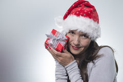 Beautiful woman in a red santa hat Stock Photography