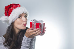 Beautiful woman in a red santa hat Royalty Free Stock Image