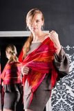 Beautiful woman in a red scarf Stock Photos