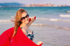 Beautiful woman with red scarf on the beach Stock Photo