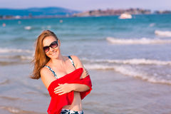 Beautiful woman with red scarf on the beach Royalty Free Stock Photos