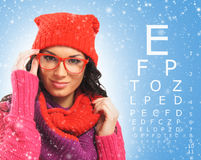 Beautiful woman with red scarf, hat and glasses Stock Photography