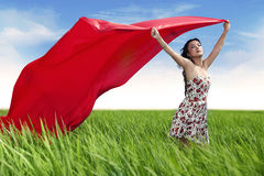 Beautiful woman with red scarf outdoor Stock Image