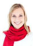 Beautiful woman with a red scarf smiling Stock Image