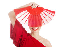 Beautiful woman in red sexy dress with fan. Stock Photography