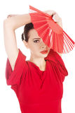 Beautiful woman in red sexy dress with fan. Stock Photos