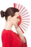 Beautiful woman in red sexy dress with fan. Royalty Free Stock Images