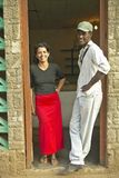 Beautiful woman in red skirt and black man posing for camera in the Valle de Vi�ales, in central Cuba Stock Photos