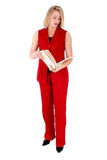 Beautiful Woman in Red Sleeveless Business Suit Looking At Folde Stock Photo