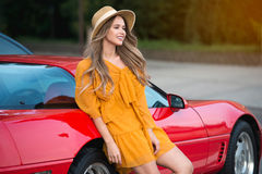 Beautiful woman with red sport car on summer vacation traveling concept Royalty Free Stock Image
