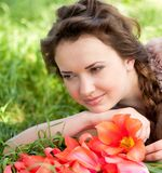 Beautiful woman with red spring tulips Stock Photo
