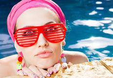 Beautiful woman with red sunglasses Stock Images