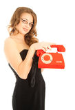Beautiful woman with red telephone smiling Stock Images