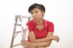 Beautiful woman red top holds plastic bottle Royalty Free Stock Photos