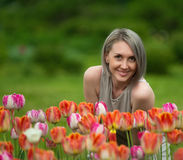 Beautiful woman and red tulip Stock Images
