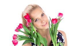 Beautiful woman with red tulips bouquet of flowers Stock Images