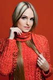 Beautiful woman in red with very long hair. Royalty Free Stock Image