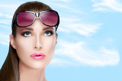 Beautiful Woman in Red Violet Shades Looking up. Bright Makeup a Stock Photo