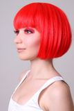 Beautiful woman in red wig Stock Images