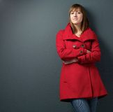 Beautiful woman in red winter jacket Stock Photo