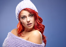 Beautiful woman redhair on blue Stock Photo