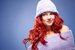 Beautiful woman redhair on blue Royalty Free Stock Image