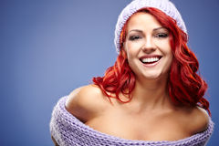 Beautiful woman redhair on blue Royalty Free Stock Photography
