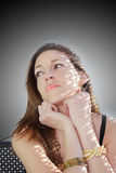 Beautiful woman in the reflections of shadows Stock Photography