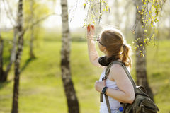 Beautiful woman with regard to branches of the trees. Stock Photography