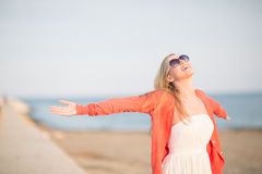 Beautiful woman rejoicing at the sea Royalty Free Stock Photos