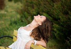 Beautiful woman relax on the bench Stock Photography