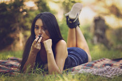 Beautiful woman relax and eat a fruit Stock Photography