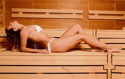 Beautiful woman relax taking sauna in spa.  Royalty Free Stock Images