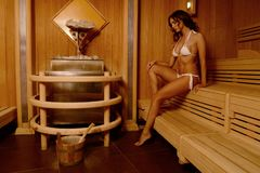 Beautiful woman relax taking sauna in spa.  Royalty Free Stock Photography