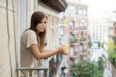 Beautiful woman relaxed cheerful drinking tea coffee at apartment balcony terrace. Young beautiful woman on her 30s relaxed and cheerful drinking hot tea or stock photos