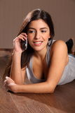 Beautiful woman relaxed talking on telephone Royalty Free Stock Photo