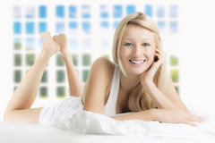Beautiful woman relaxing. Portrait of beautiful woman relaxing on the bed at home Royalty Free Stock Photos