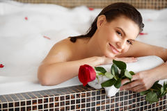 Beautiful Woman Relaxing in Bath With Rose. Body Care Royalty Free Stock Image