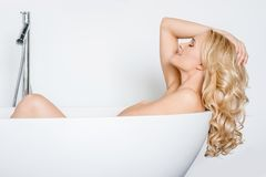 Beautiful woman relaxing in a bath tub Stock Photography
