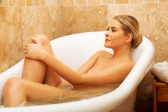 Beautiful woman relaxing in bathtub looking up Royalty Free Stock Images