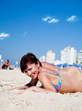 Beautiful woman relaxing on the beach Royalty Free Stock Images