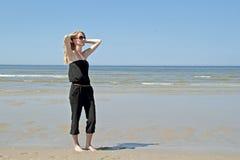 Beautiful woman relaxing at the beach Stock Photo