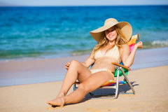 Beautiful Woman Relaxing on the Beach Stock Photo