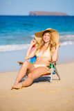 Beautiful Woman Relaxing on the Beach Stock Image