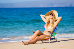 Beautiful Woman Relaxing on the Beach Royalty Free Stock Photo